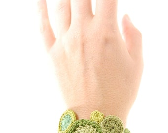 crochet cuff bracelet in forest green and sea foam handmade by Even Howard. Women's fiber art bracelet.