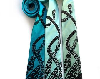 Squid Tie. Octopus tentacles necktie. Sucker silk tie. Men's tie. Black print on teal, greens & blues. Standard or narrow size.