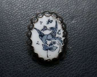 rainbird - blue and white enamel delft winter bird brooch - handmade jewelry with repurposed vintage objects