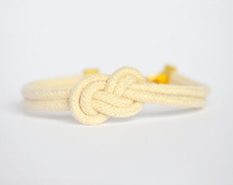Natural beige infinity knot nautical cotton rope bracelet with gold anchor charm
