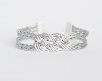 Metallic silver double infinity knot nautical rope bracelet with silver anchor charm