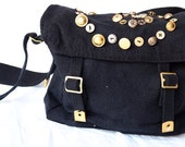 Black canvas army bag with brass button embellishment