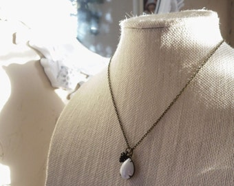 Pinecone in the Snow Necklace with a pinecone charm and pear shaped vintage pearl pendant