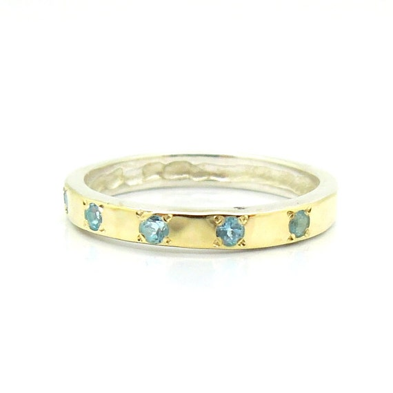Blue topaz ring with slightly hammered gold on top of silver