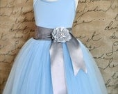 Light blue and silver Flower Girl Tutu. Fully sewn tutu with satin sashed waist. Aqua blue, light blue, navy or royal blue.
