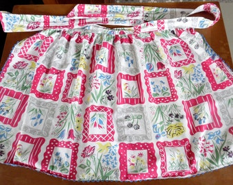 50s printed cotton floral half apron with blue rick rack