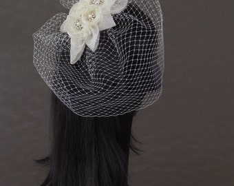 Bridal headpiece / fascinator offwhite with many Swarovski and pearl buttons and birdcage veil on aliceband