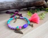 Boho Wing Ohm Bracelet / pink tassel. DULCET FREEDOM Turquoise purple beaded bracelet. Adjustable. Acrylic Czech glass beads. Bohemian look