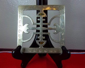 Vintage Brass Trivet With Asian Designs And Etched Leafs