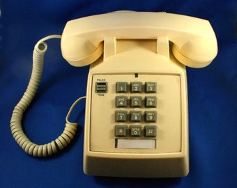 vintage Telephone 1980s push button Light beige plastic phone with tone or pulse setting