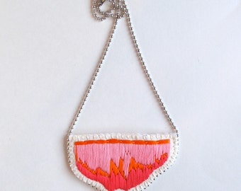 Abstract bib necklace hand embroidered in ombre colors of orange, light and hot pink on a silver ball chain perfect for Spring