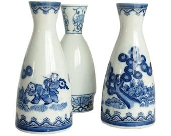 Vintage Japanese Porcelain. Vases or Sake Flasks. Set of Three. Blue and White. Floral Asian Designs.