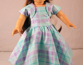 Sleeveless party dress with shrug. Fits 18-inch dolls