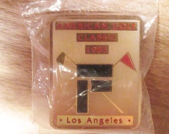 One  1985 Olympic pins. - American Golf Classic in Los Angeles  - Still in original package - Estate FInd