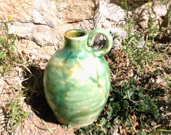 jug green pottery jug pottery bottle with a handle