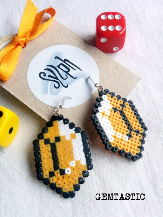 Simple but geeky Zelda game inspired pixelated Gemtastic earrings in warm orange tone made of Hama Mini Perler Beads