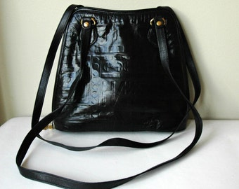 Designer black Fratelli embossed leather purse.
