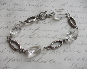 Clear quartz stones and silver bracelet