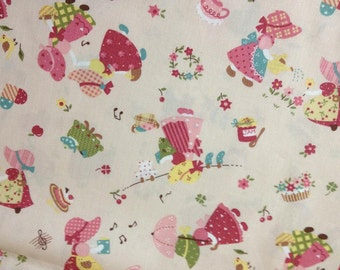 SALE-Half Yard of Playful Sunbonnet Sue fabric, Made in Japan.