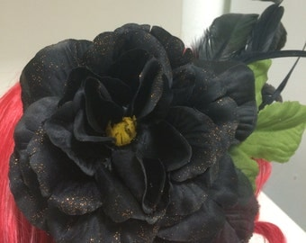 black flower and feather hair clip accessory