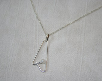 Sterling Silver Pearl Embrace Pendant on Chain