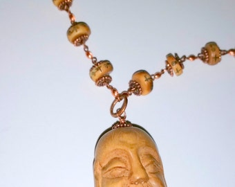 For the Love of      (Carved Buddha Head Necklace)