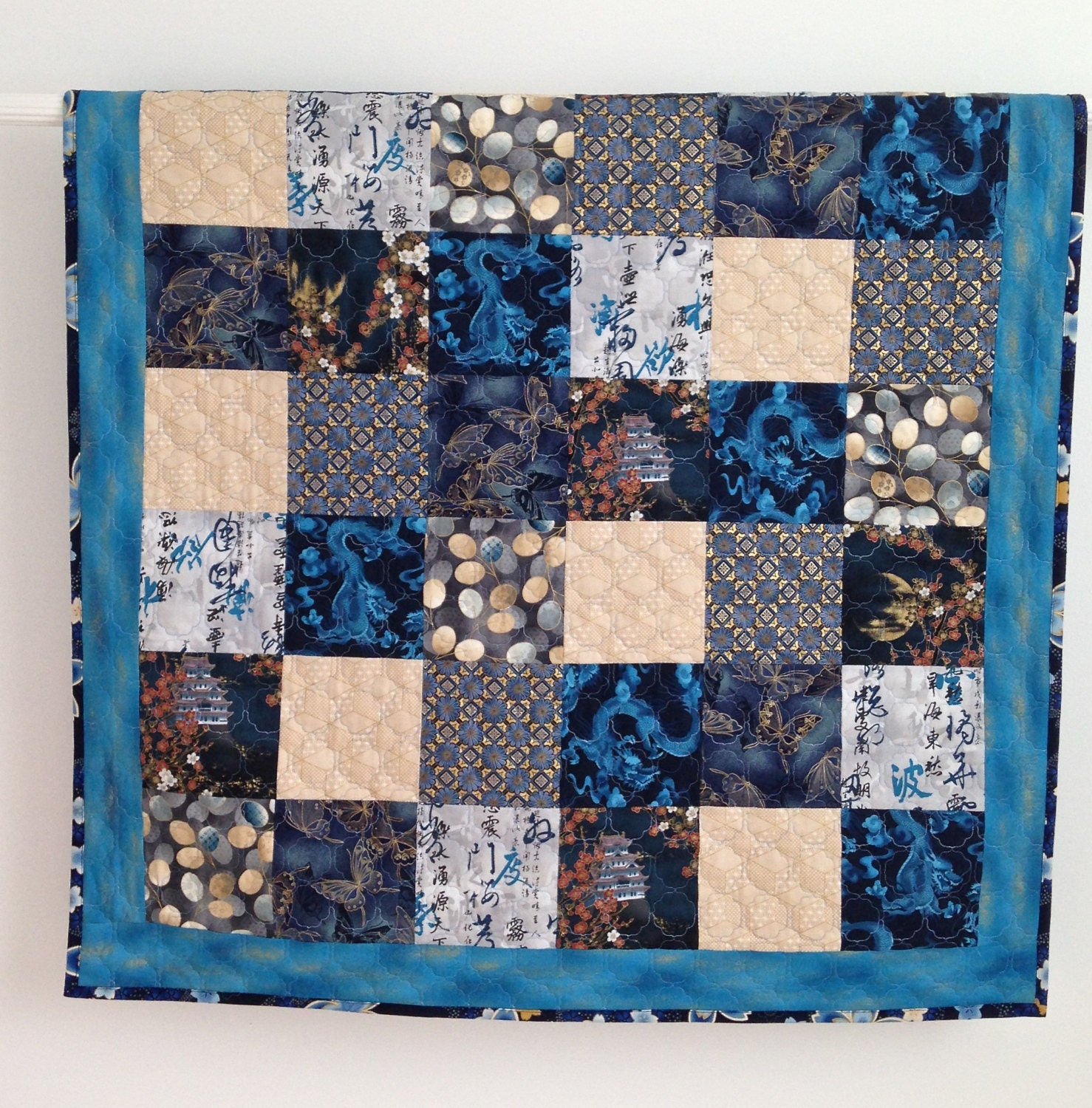 Baby boy quilt featuring asian fabrics royal blue dragons for Quilt material for boys