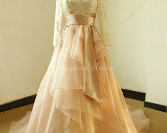 Modest blush A line organza lace wedding dress with long sleeves