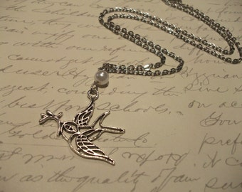 Silver bird charm necklace with pearl