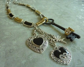 SALE! Glamor Necklace: Key, Rhinestones, Angel, Hearts, Gold, Black, Silver Etched Chain Links and Filigree Rings on 34 Inch Chain
