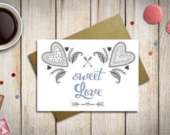 Valentines Card printed on paper with hearts and romantic decorations, with kraft envelope