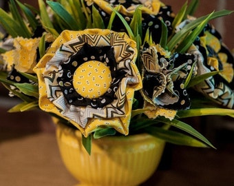 Sunshine yo yo fabric floral arrangement in bright yellow ceramic container
