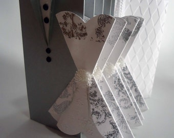 Card Grooms with later adaptation to put the gift part . Grooms in silver and white handmade.