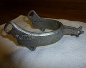 Single vintage aluminum spur from the 50's or 60's.  Great decor item, western rodeo spur