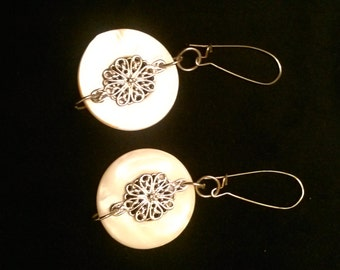 Pearly white and silvertone earrings