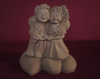 """Lil sweet #3419, boy and girl angels holding hands on heart base,5"""" molded pecan resin figurine,unpainted"""