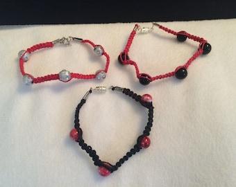 Red and black bracelet trio