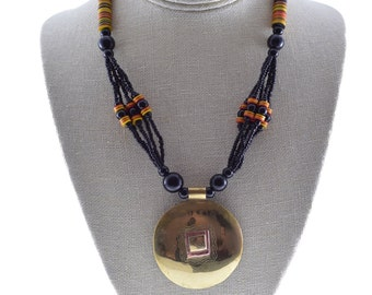 "African Tribal Beaded Necklace with Brass Pendant, Yellow & Red Koffi Disks, and Ceramic beads, ""Dunuya"" -  from Mali"