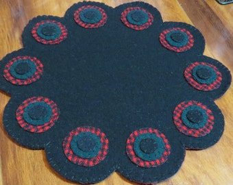 Hand stitched, felted wool, penny rug candle mat