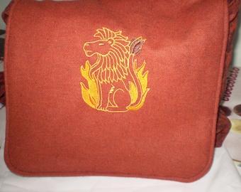 lion embroidered terracotta wool messenger bag