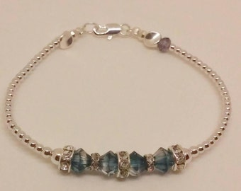 925 Sterling Silver Beaded Bracelet with genuine Shimmery Blue Swarovski Crystals, finished with a silver lobster clasp. One of a kind!