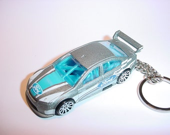 3D Ford Falcon race car custom keychain by Brian Thornton keyring key chain finished in silver racing color trim diecast metal body