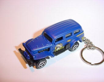 3D Jungle Crawler truck custom keychain by Brian Thornton keyring key chain finished in blue 4x4 pick up offroad dinosaur hunter