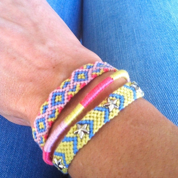 Set of 3 bracelets. Handmade Pastel Peach Blue and Yellow Star Spikes Tribal Friendship Bracelet Set.