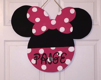 Door Hanger - Wood Cut Out - Minnie Mouse. This adorable Minnie Mouse can be changed to better meet your style!