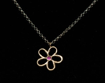 14k Solid Gold Daisy Pendant w Genuine Ruby on sterling rolo chain.