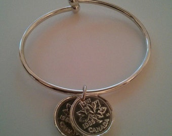 Silver plated pennies on a sterling silver bracelet