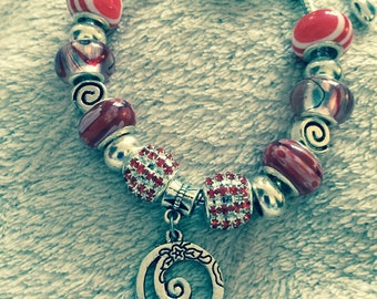 SALE Silver tribal swirl charm bracelet with red and crystal european beads