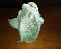 Popular items for vintage door stop on etsy for Fish door stop