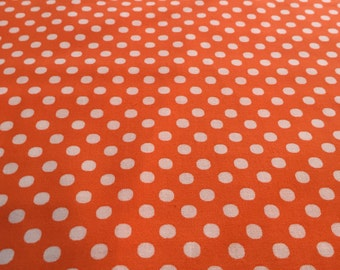 Lecien Color Basic fabric.  Orange with white dots.  4506